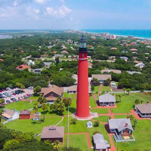 An aerial view of Ponce Inlet Lighthouse shows the inland waterway and the Atlantic Ocean