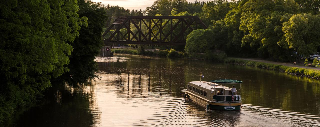 A boat sailing along the Erie Canal in Pittsford, NY