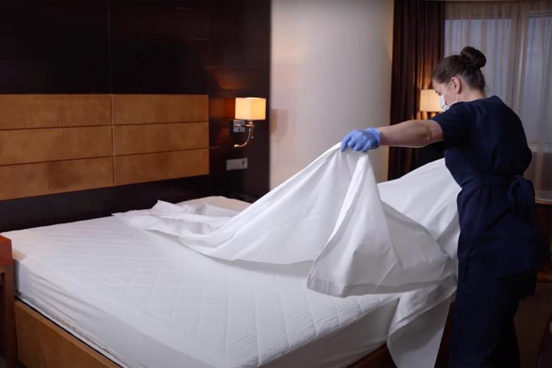 Making beds in hotel rooms