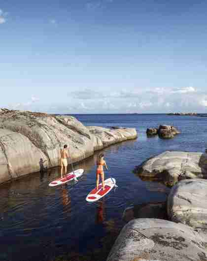 SUP paddling at the coastline of Blindleia in southernmost Norway