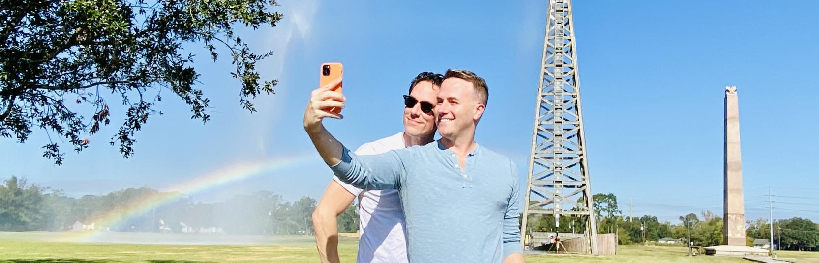 Couple taking selfie in front of the Spindletop Rainbow in Beaumont, TX