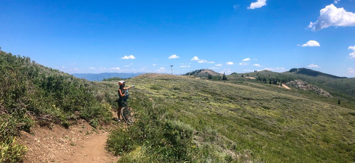 Mountain Biker enjoying the scenic view on mountain trail