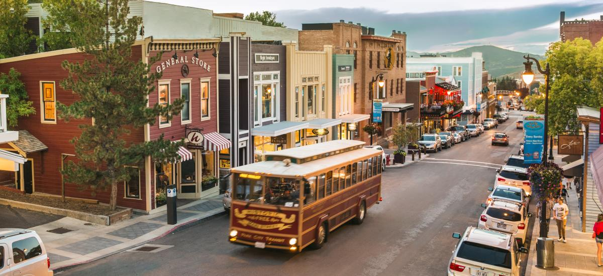 Trolley driving up Historic Main Street in summer