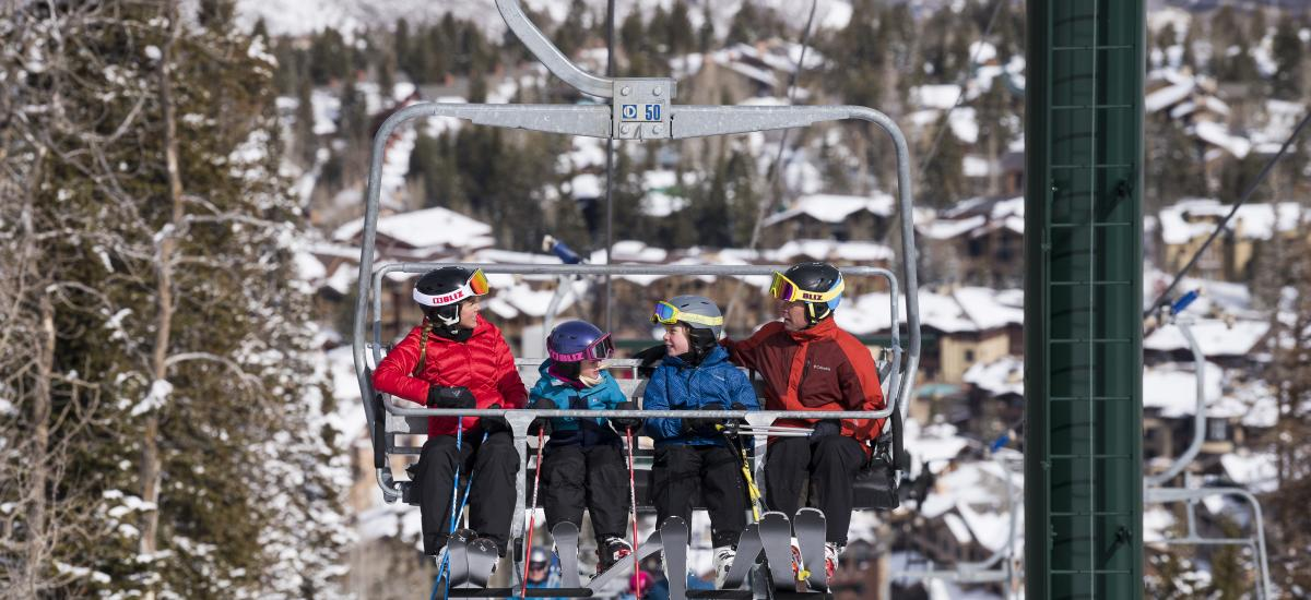 Family on chairlift while skiing at Deer Valley Resort