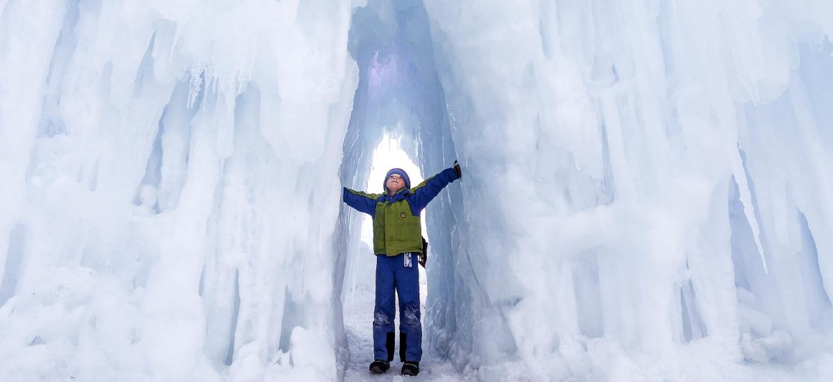 Boy standing in Ice Castle hallway
