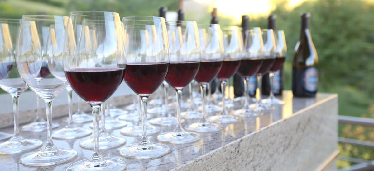 a row of red wine in glasses