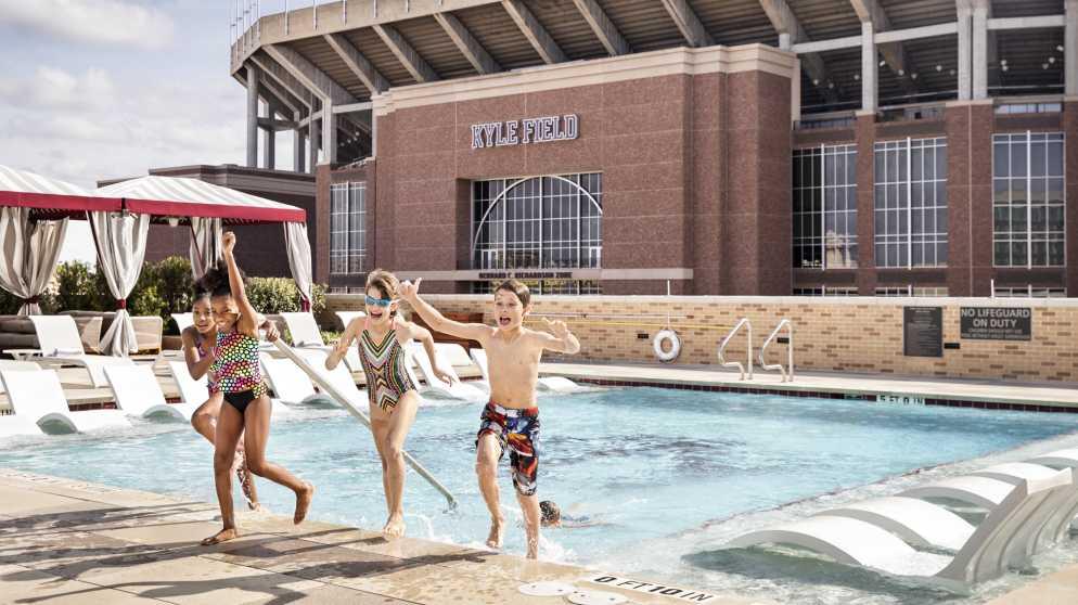 TAMU Hotel Kids at Pool