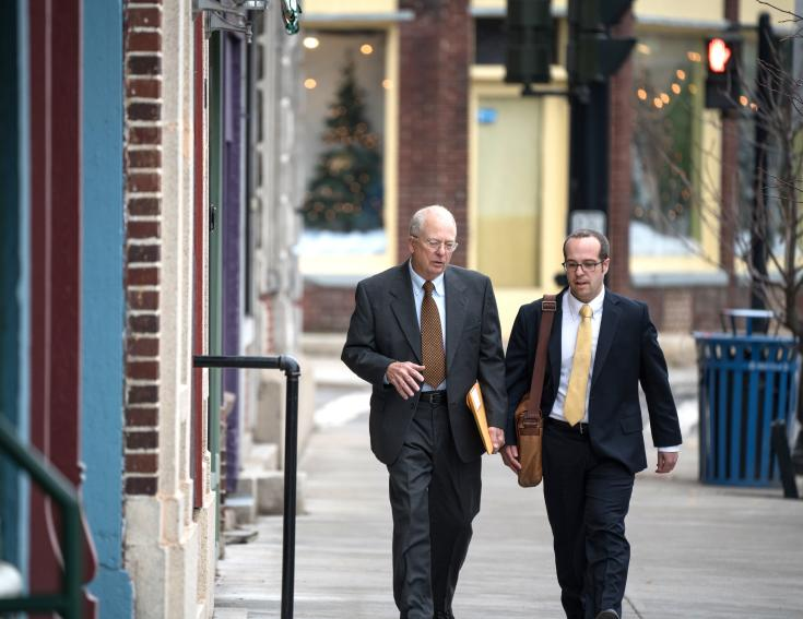 Two businessman walk in the Downtown district of Waterloo