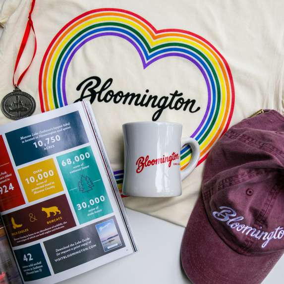Coffee mug, baseball hat, ornament, t-shirt, and visitors guide