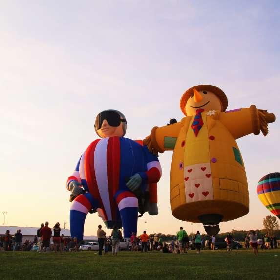 Three hot air balloons launching at the Indiana Kiwanis Balloon Festival