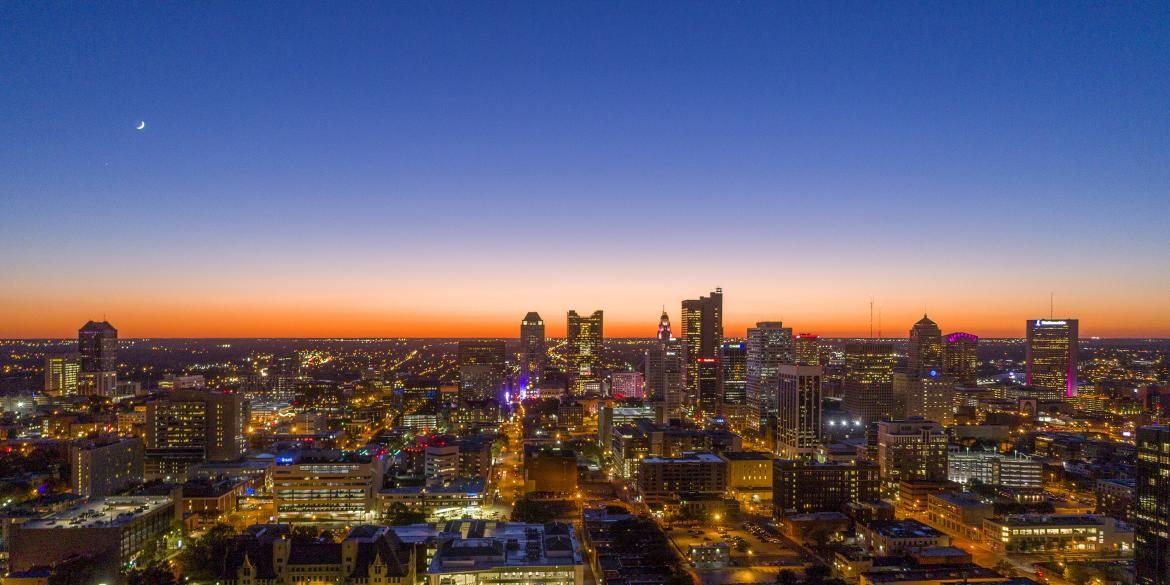 Columbus Skyline At Dusk With City Lights Shining In Buildings