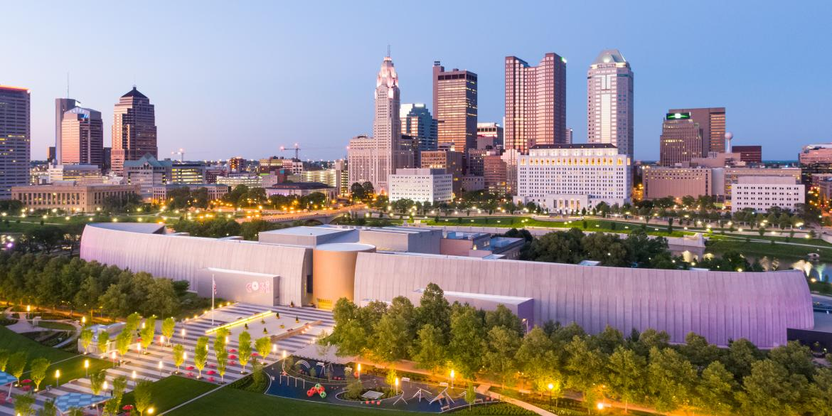 A view of COSI science museum with the Columbus skyline