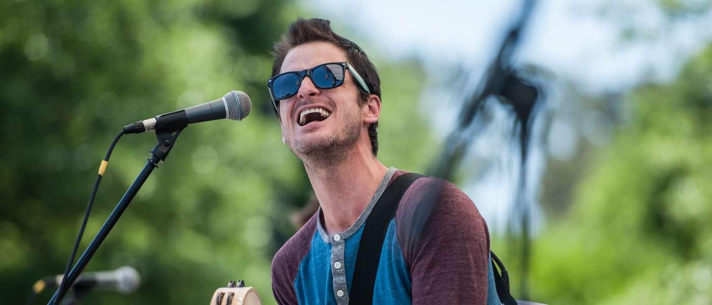 Man playing Tamborine and singing