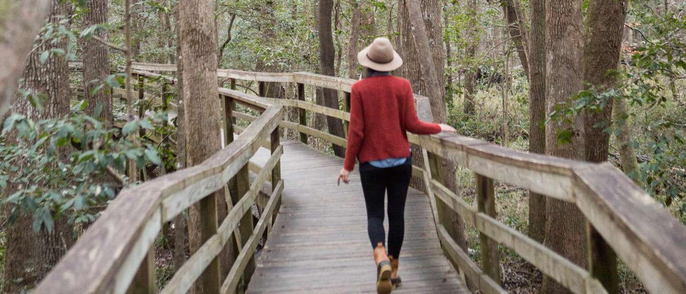 Woman walking on the Congaree National Park boardwalk