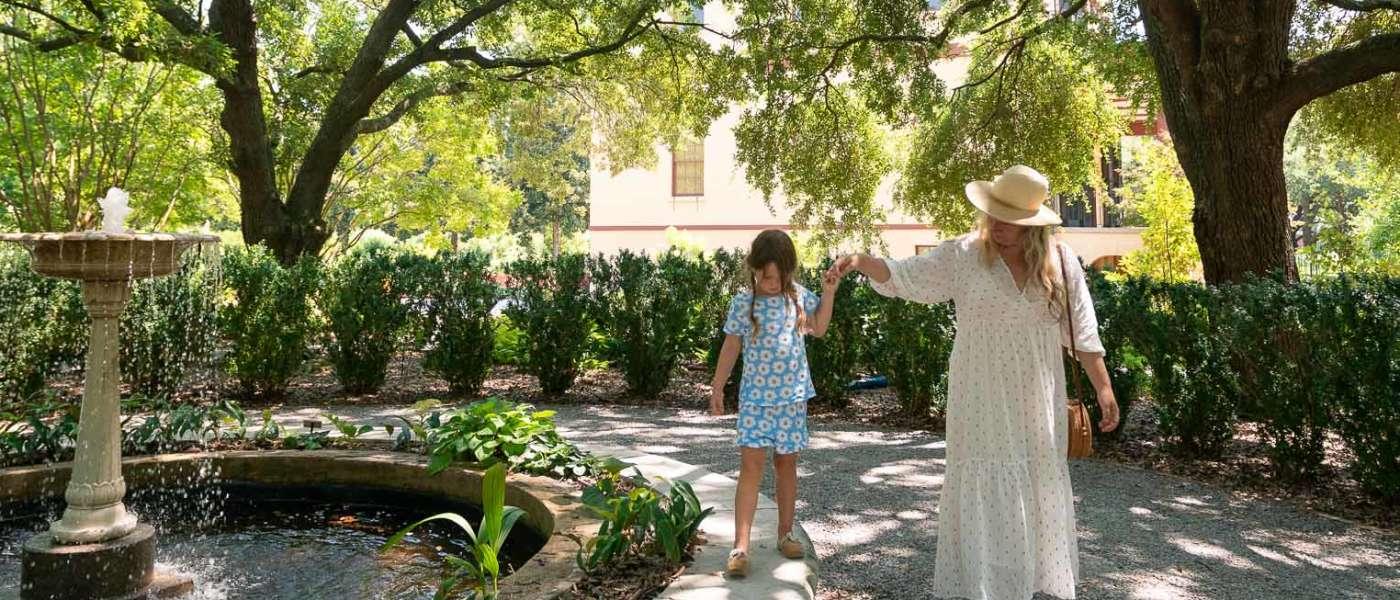 Mother and daughter walking through Historic Columbia Garden