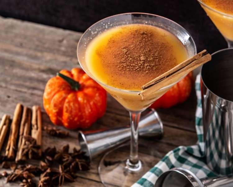 A pumpkin pie martini with cinnamon stick garnish.