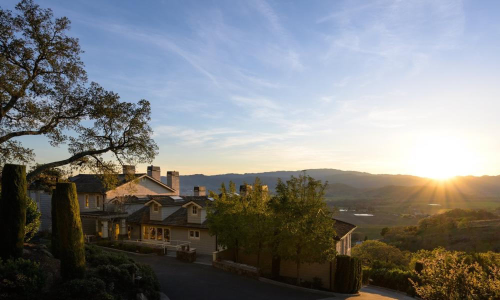The sun sets over the hills in the Stags Leap District near Napa Valley's Poetry Inn.