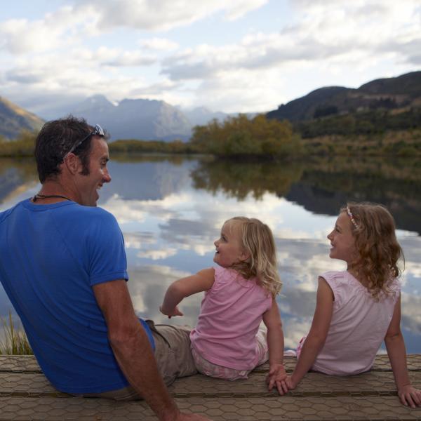 Family walking Mirror Lake, Glenorchy