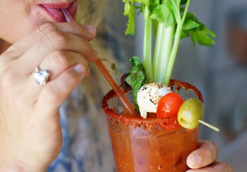 Woman drinking Bloody Mary