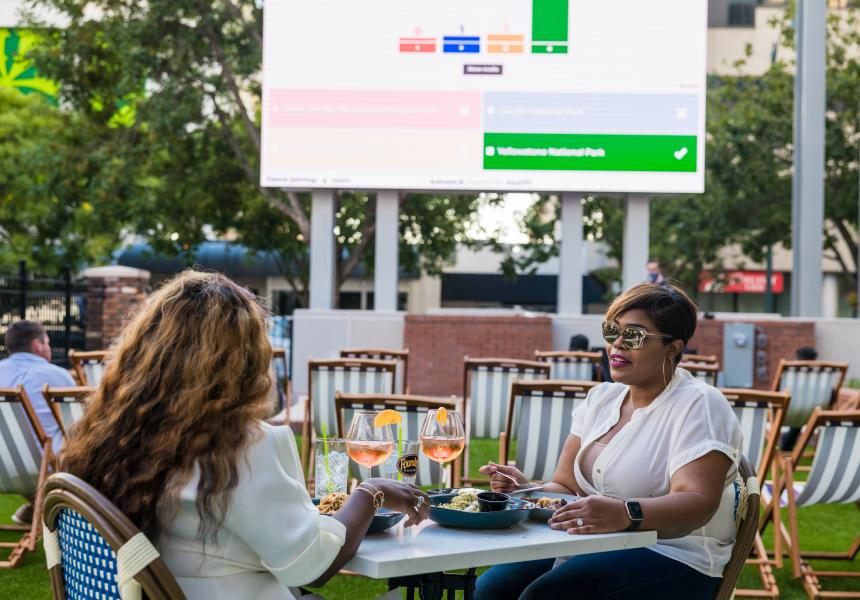 Two women dining during trivia at Market on Main