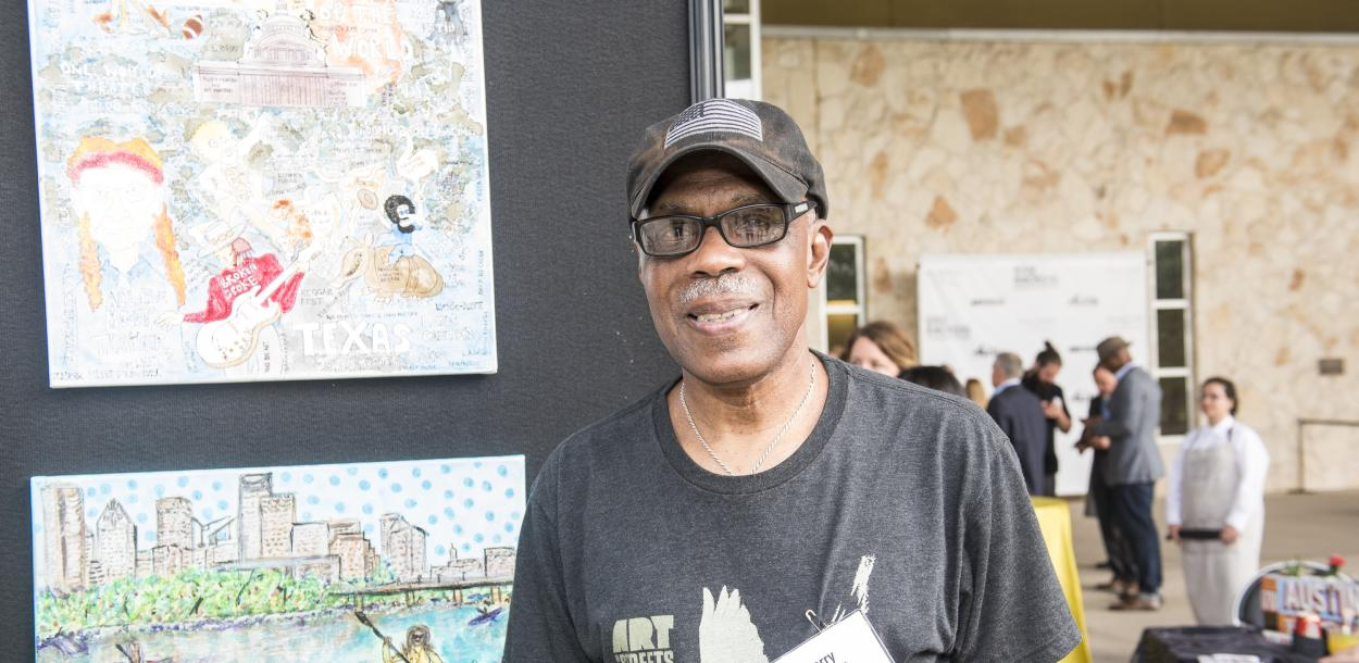 Artist Larry Williams with Art from the Streets exhibiting his work at Visit Austins Give Back Gig