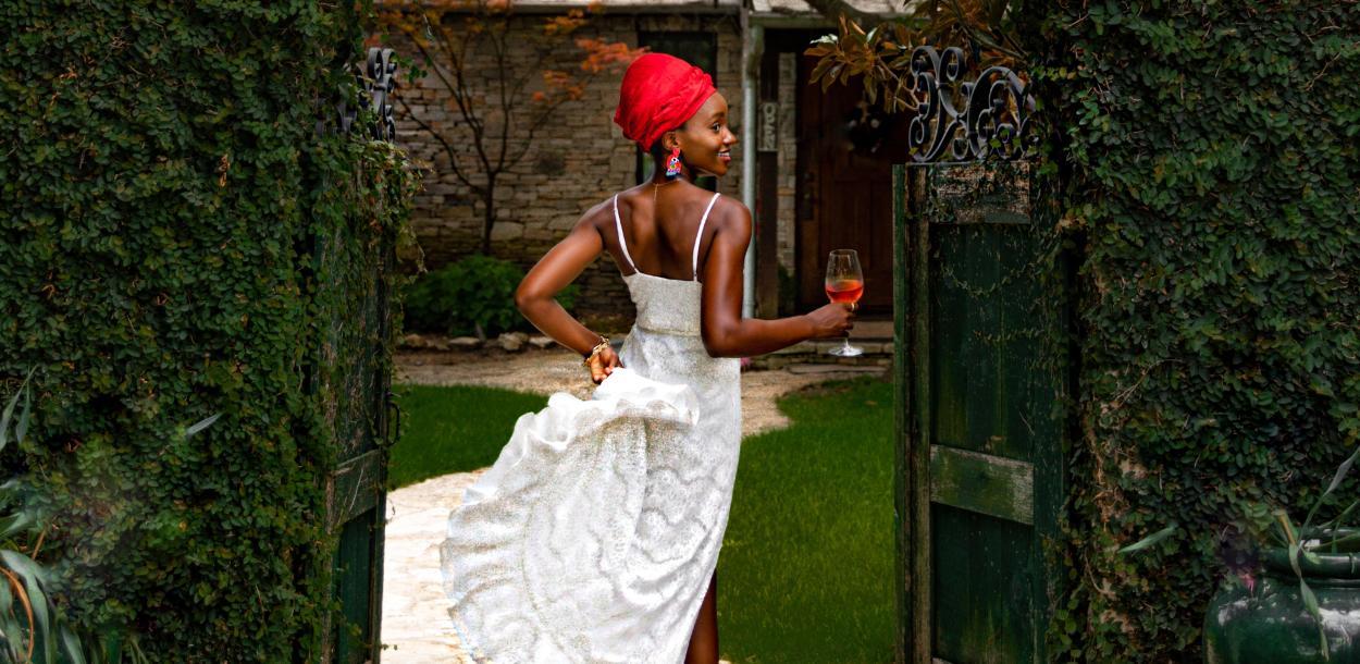 Laolu Onabanjo walks through gate at a winery in Driftwood Texas near Austin\