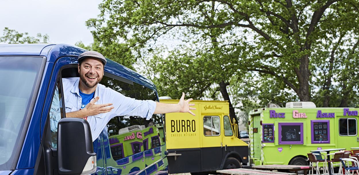 Austin Detours tour guide shows off food trucks from van in austin texas