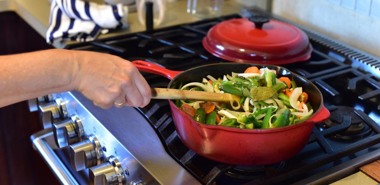 Chef cooking Chiles Jalapeños en Escabeche at El Naranjo in Austin Texas