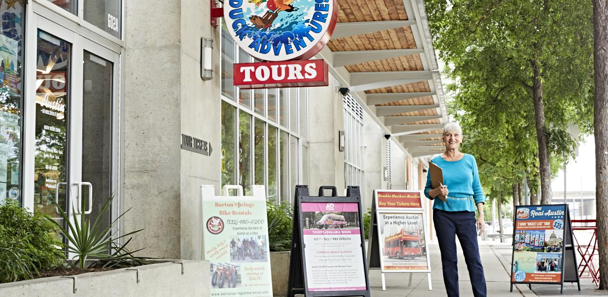 Woman at the Austin Texas Visitor Center with tours