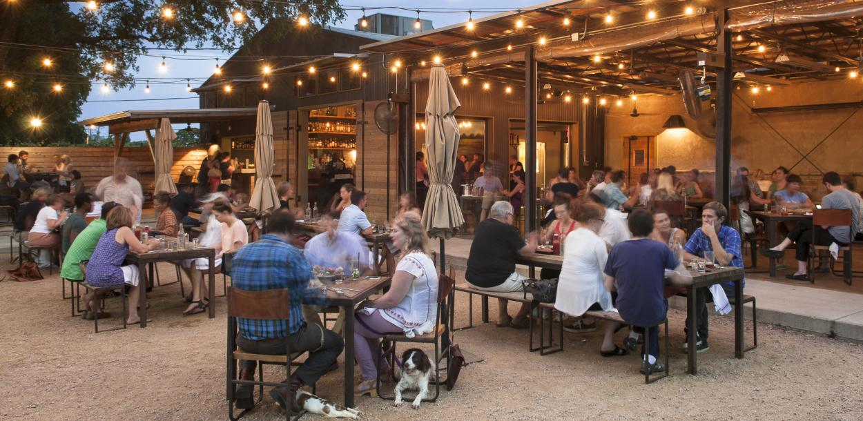people dining in the beer garden at Contigo in east austin texas