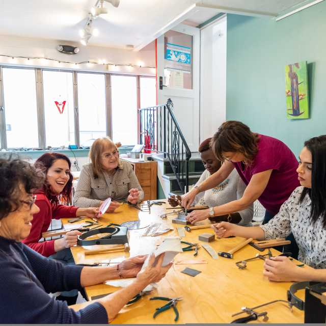 Group enjoys jewelry making class at The Watchmaker\'s Daughter