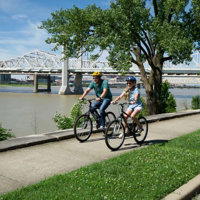 Man and woman riding bikes on the Ohio River Greenway