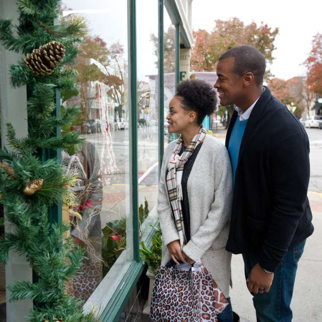 Man and woman window shopping during Christmas