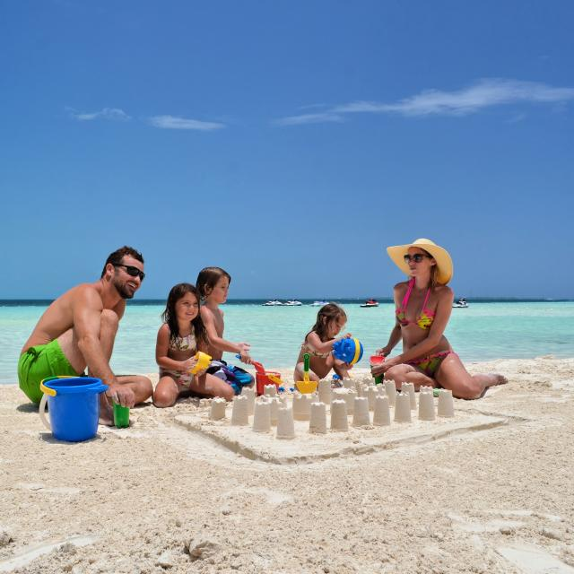 Family Making Sandcastles on Beach