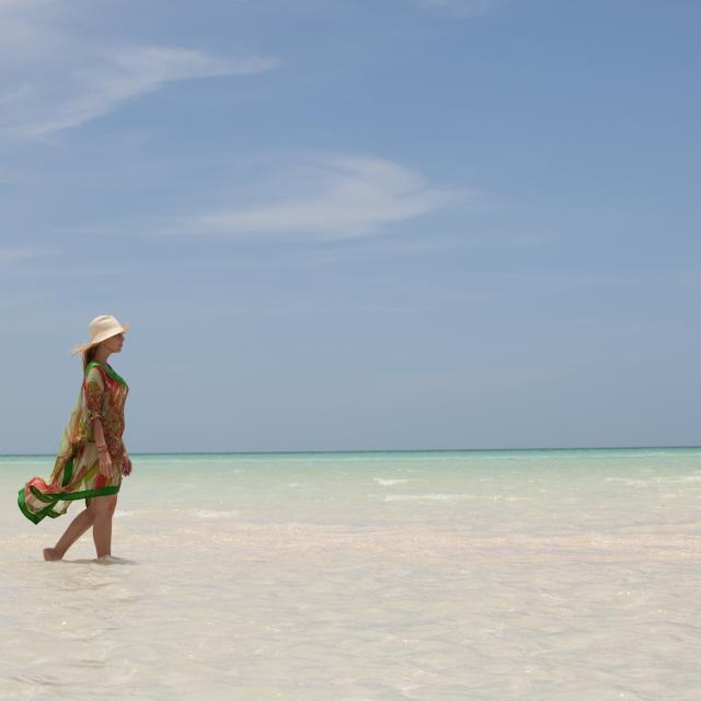 Woman Walking in Shallow Water