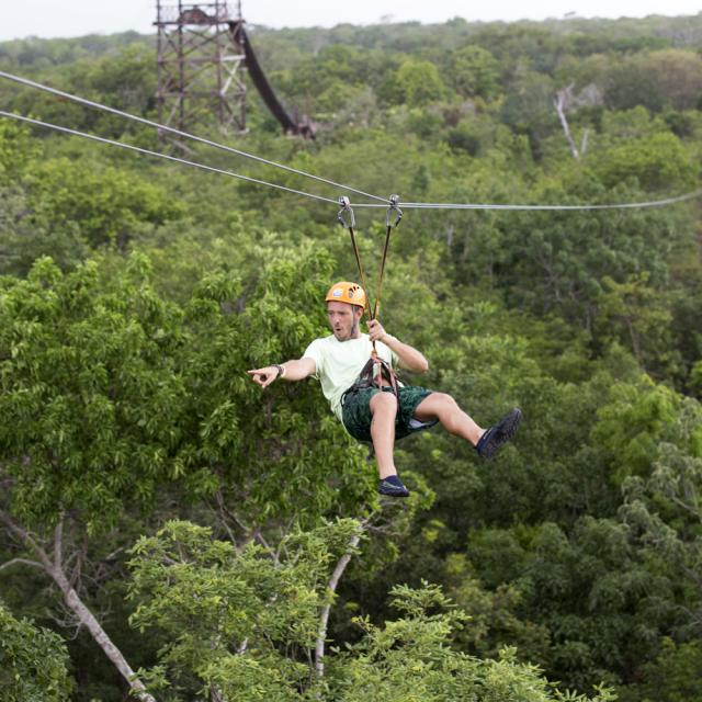 Man on Zipline Pointing