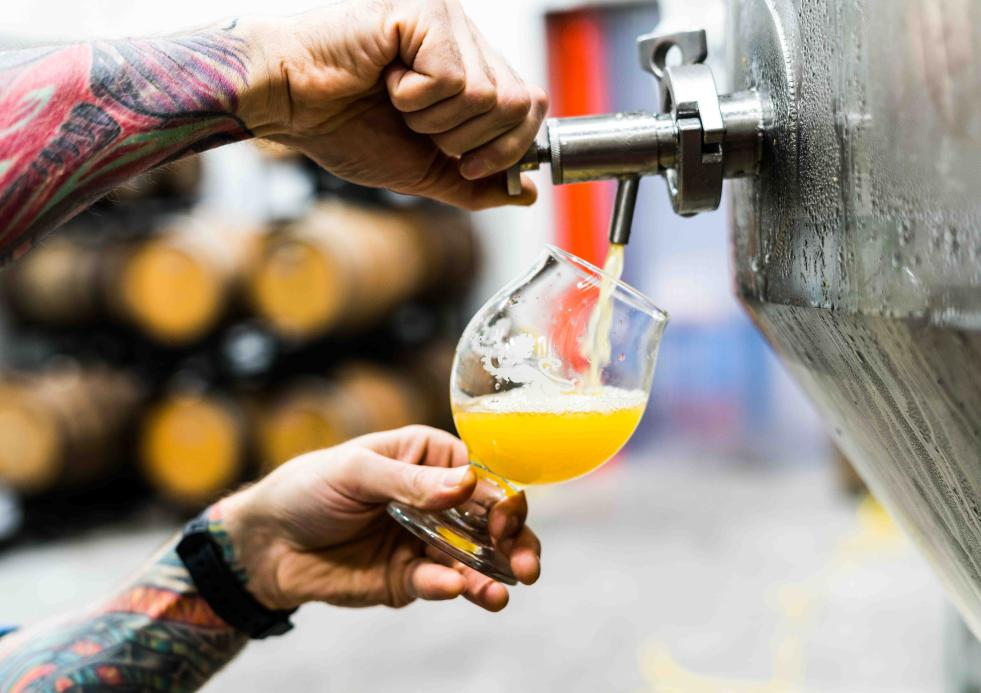 Man pouring a beer out of a tap