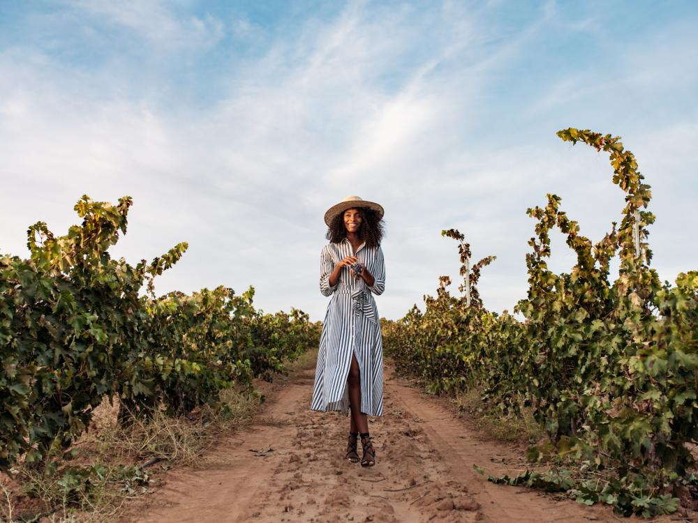 Woman Walking in Fall Vineyard