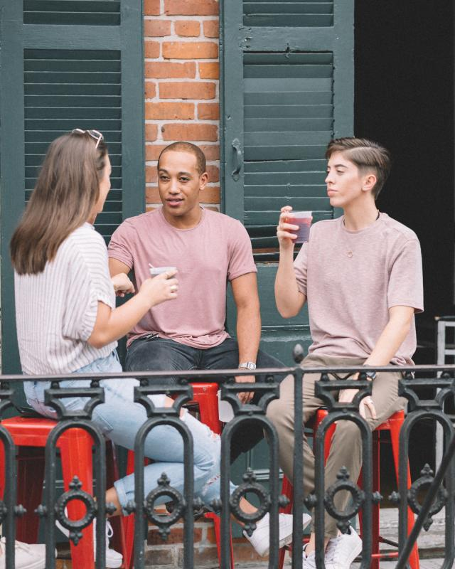 LGBTQ Friends Having Drinks on a French Quarter Balcony