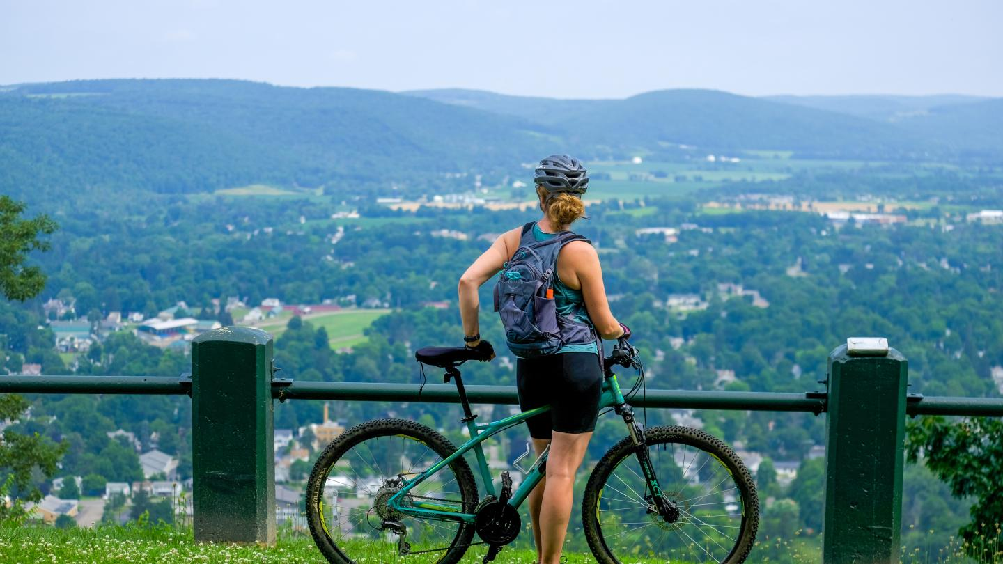 Mossy Bank Park Mountain Bike Trail Solo Cyclist at Overlook View