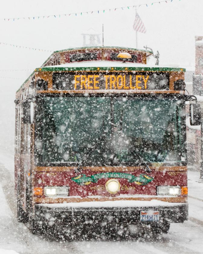 Free Trolley driving up Historic Main Street in a snow storm