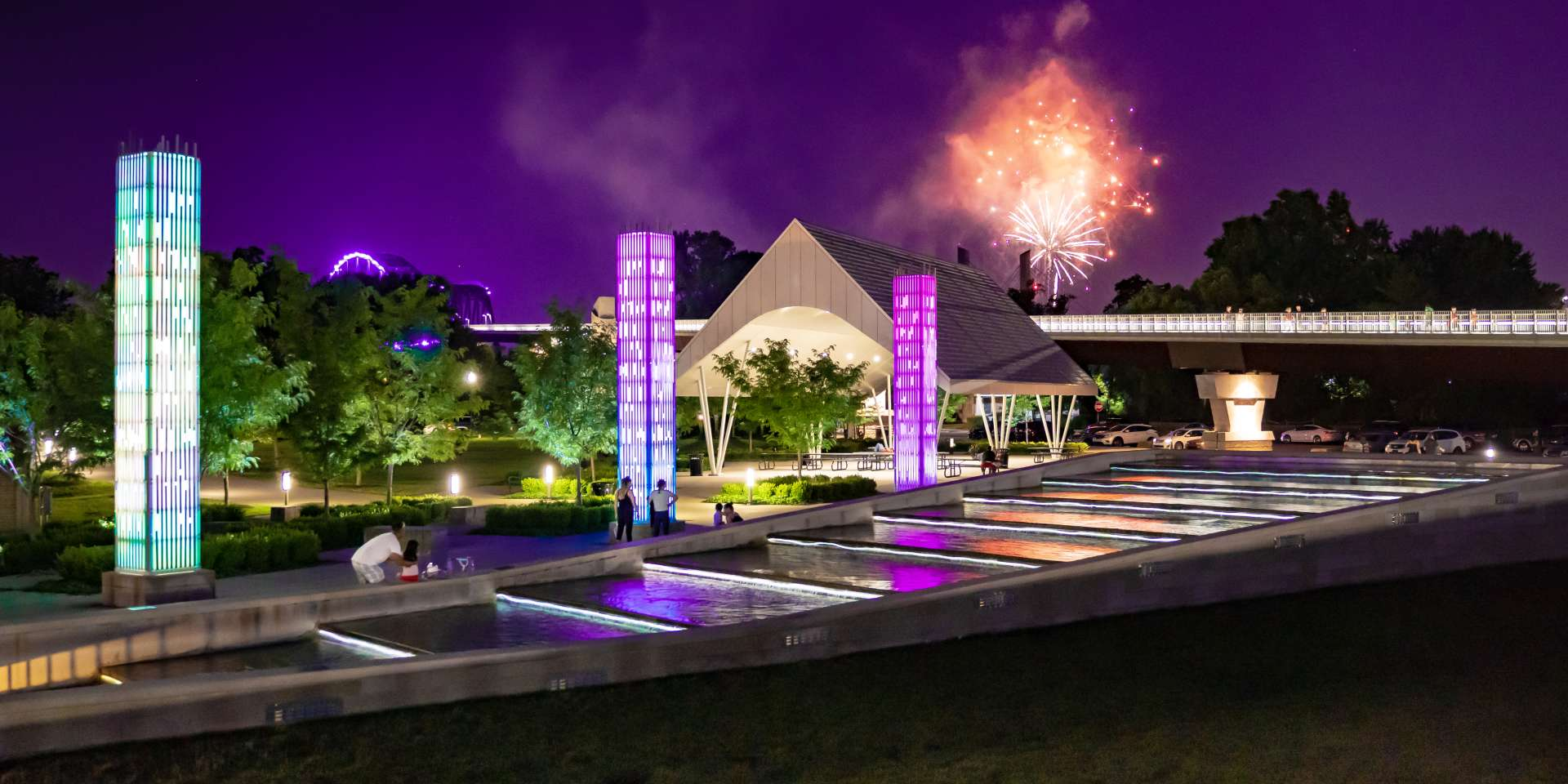 Art installations and fireworks in the night sky at Big Four Station Park in Jeffersonville