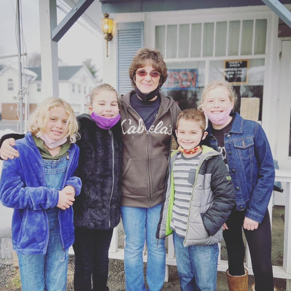Tammany with children outside Tammy's Diner