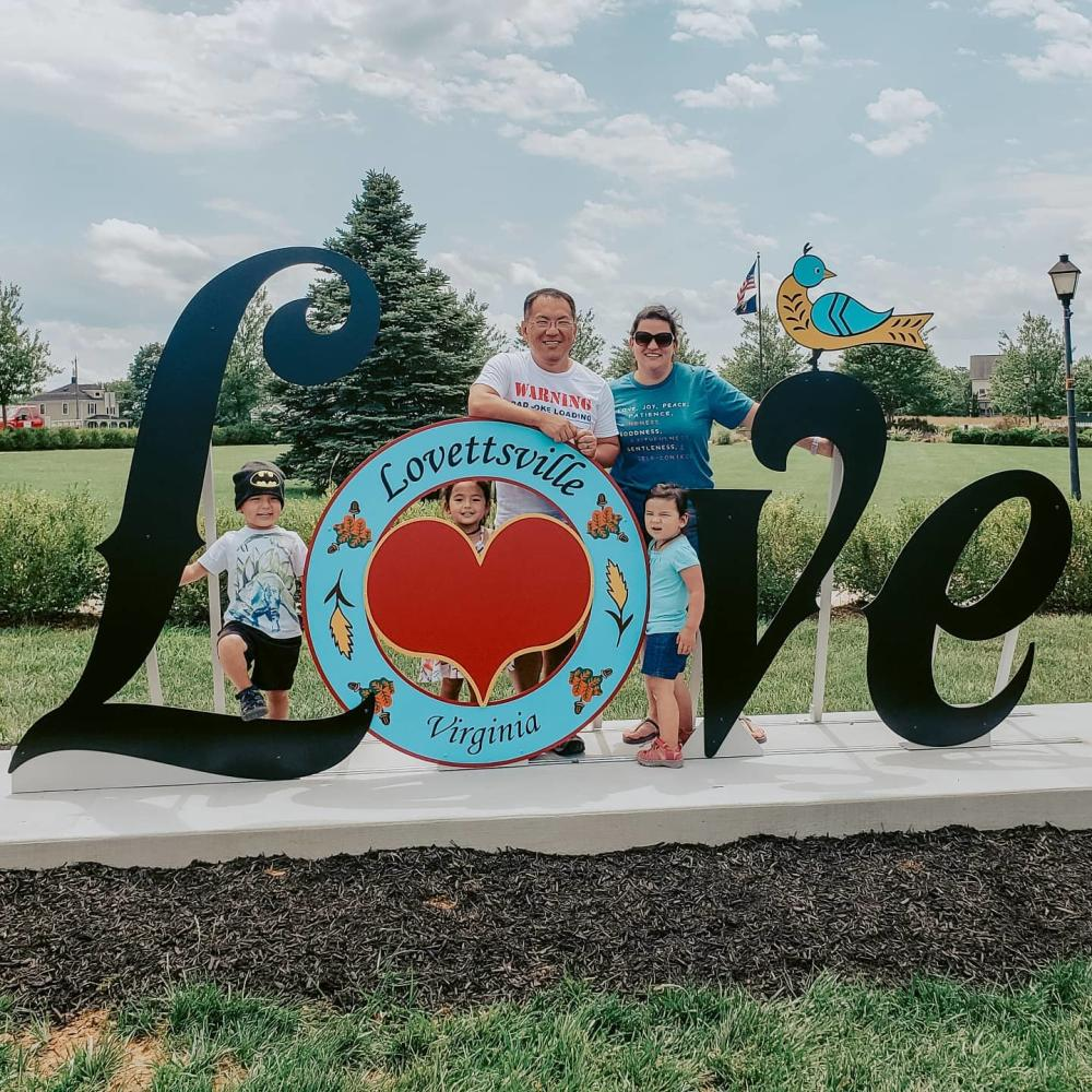 Family posing for a picture with the Lovettsville, VA Love Sign