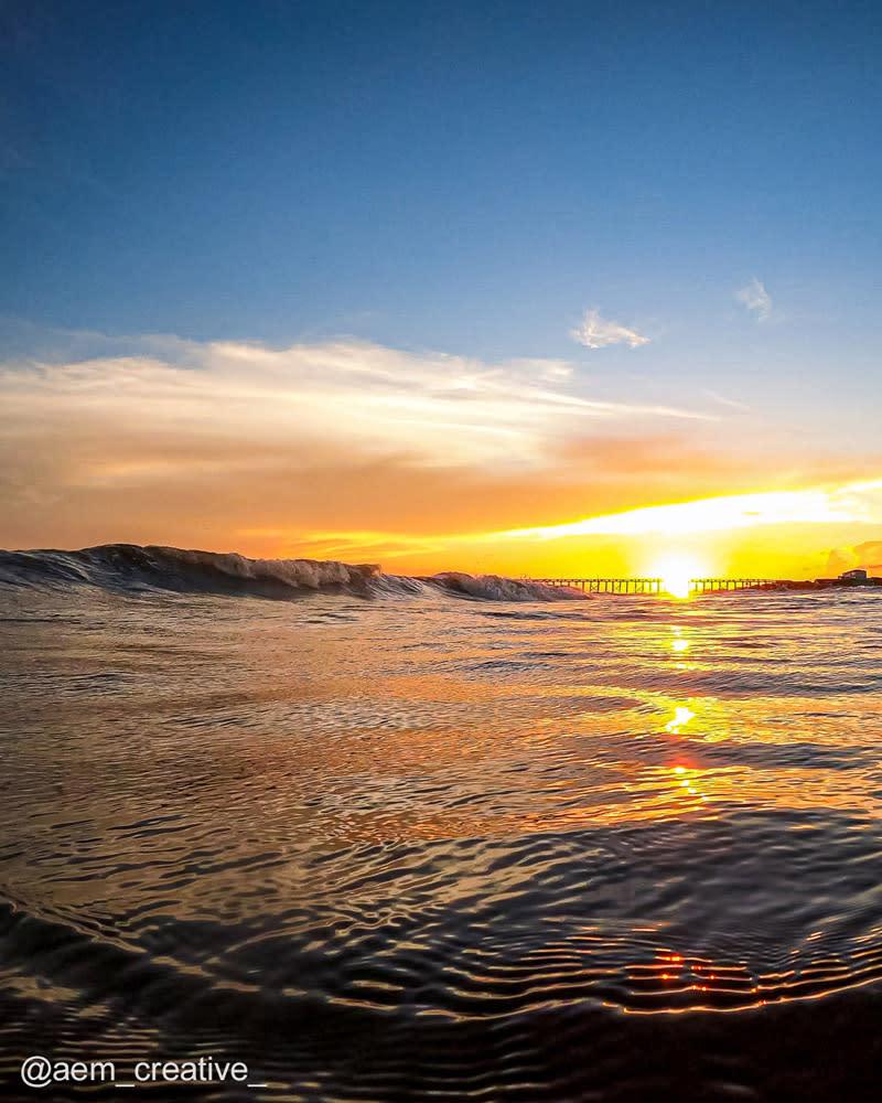 Sun setting over the ocean in Oak Island, North Carolina.