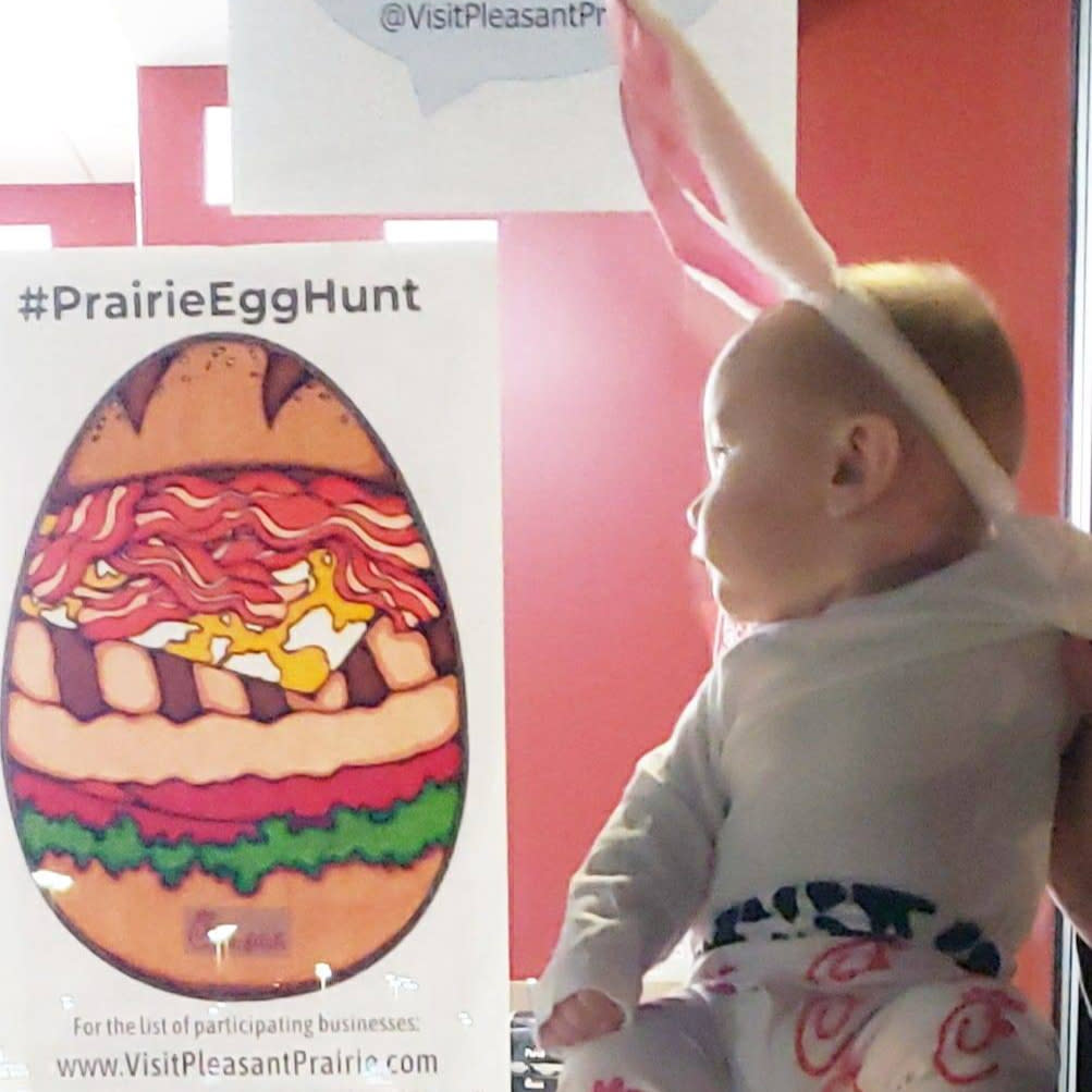 Chick-fil-A Egg Hunt Poster and Baby next to it