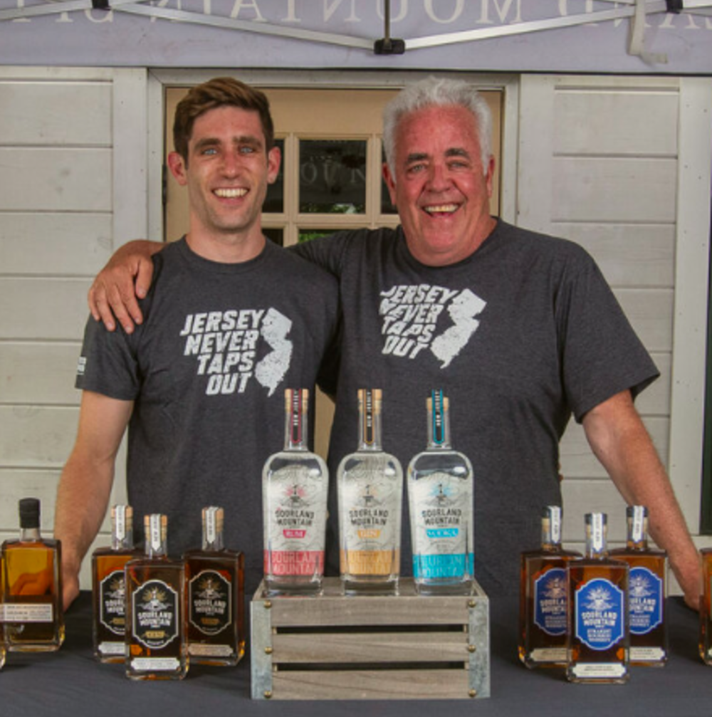 sourland mountain spirits owner, ray disch, with his line of spirits