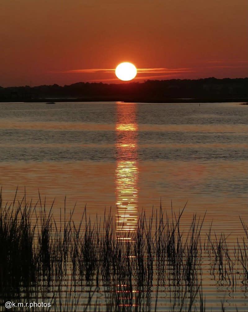 Sunset at the Point in Oak Island, North Carolina.