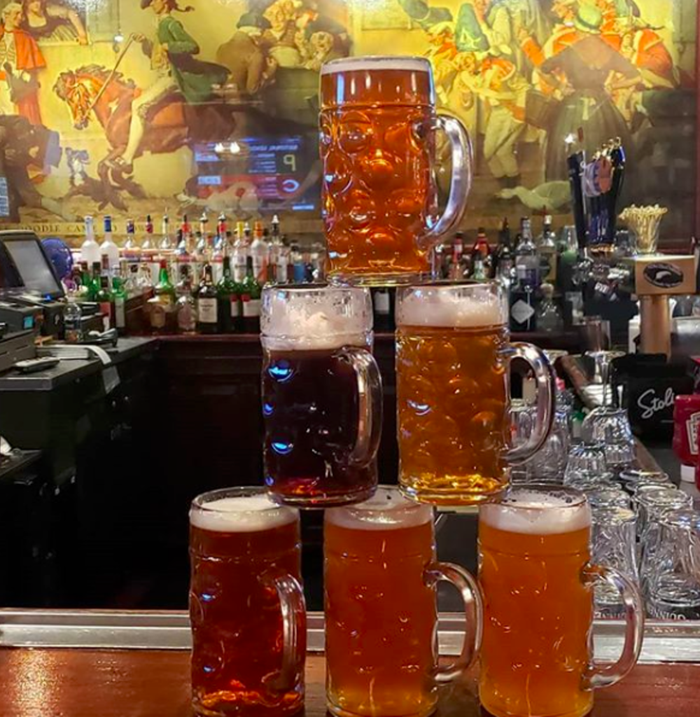 a tower of beers stacked at yankee doodle tap room