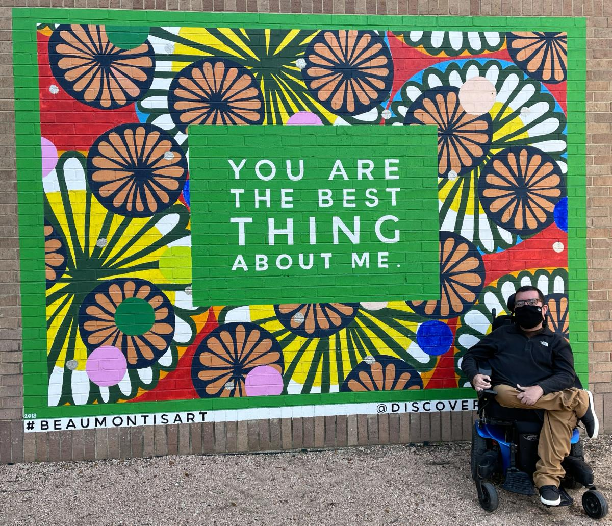 cory in front of mural saying you are the best thing about me